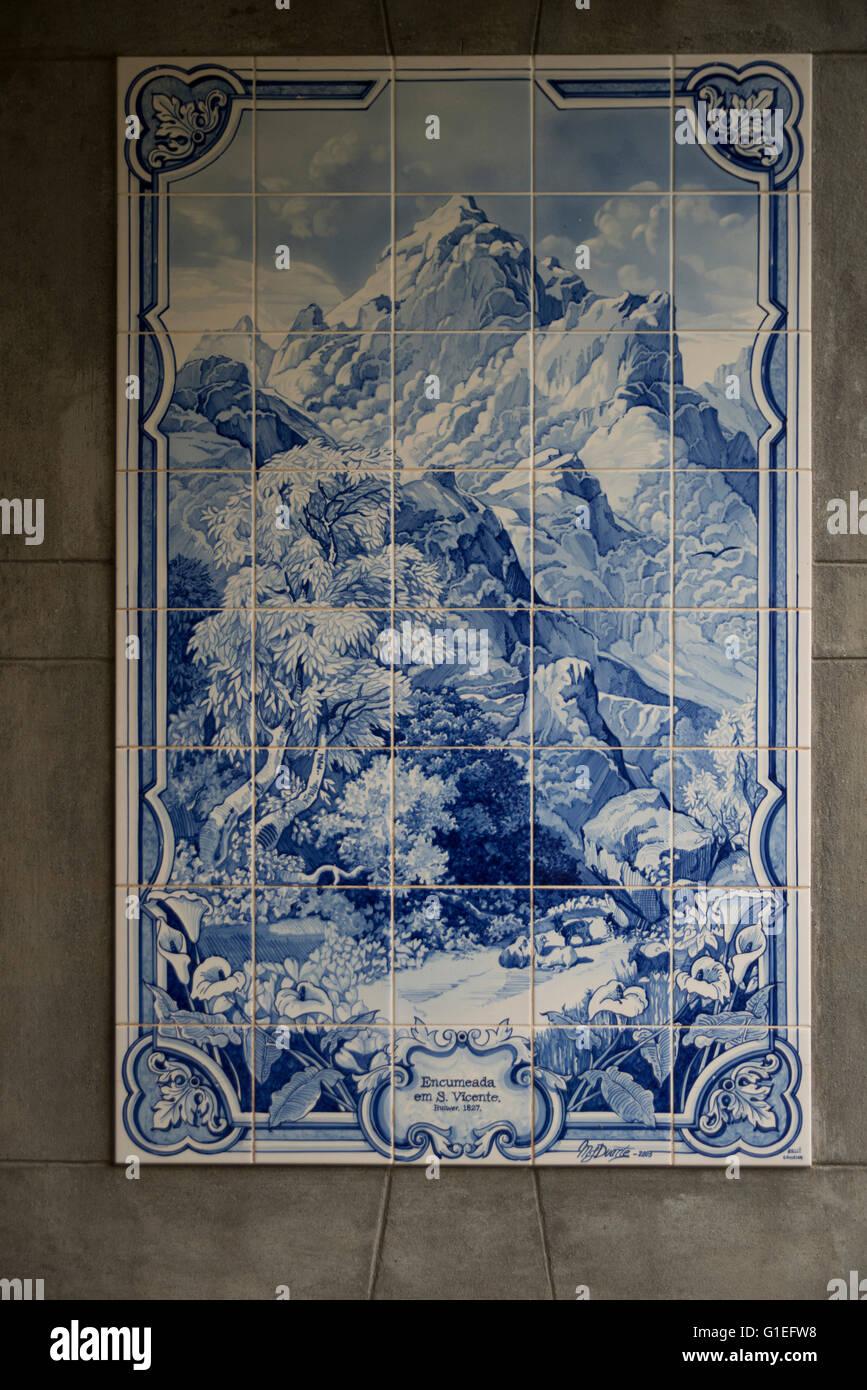 Historic azulejos (tiles) at the Grutas (Caves) de Sao Vicente, Madeira, Portugal. Blue and white ceramic tiles. - Stock Image