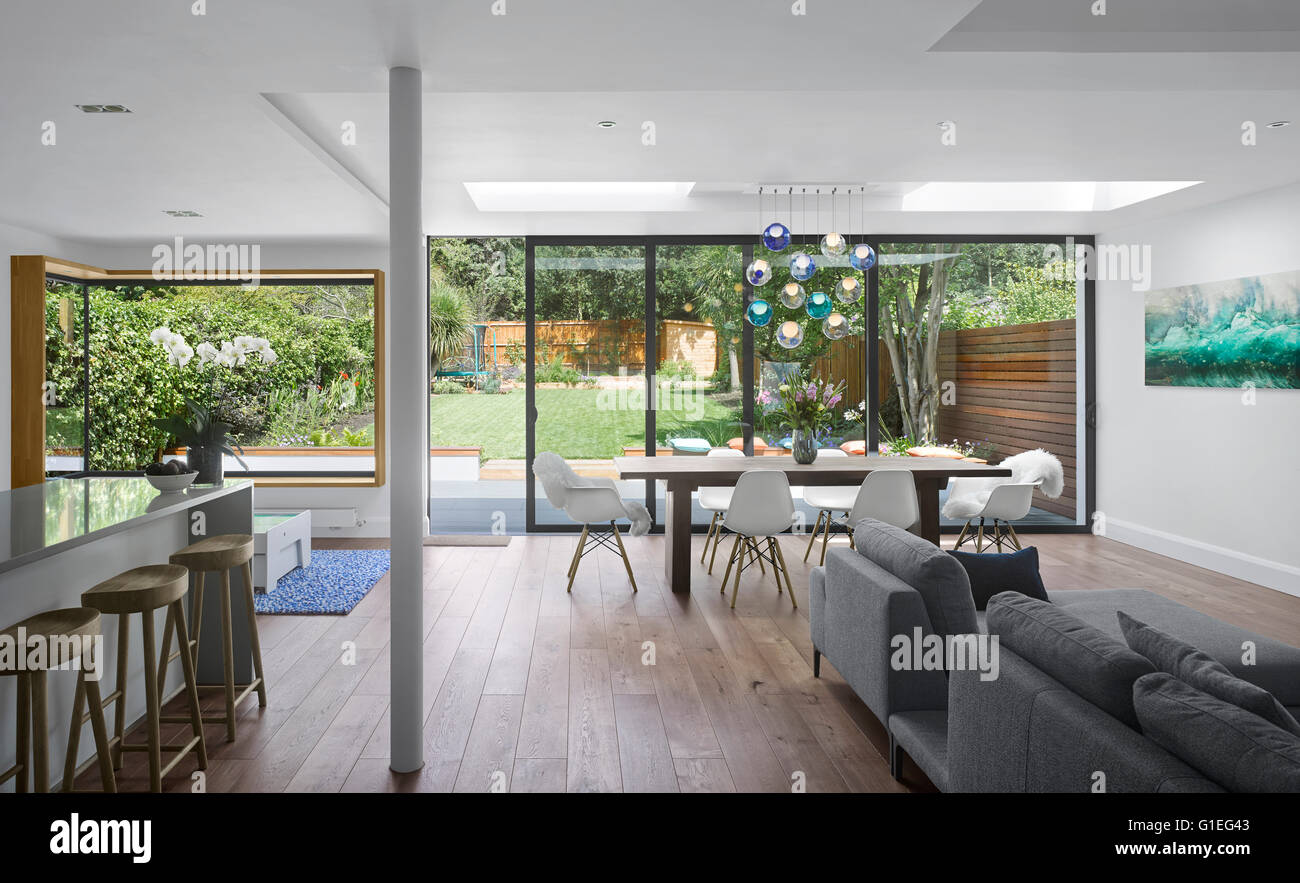 Single Storey Extension Mincheon Road London Open Plan Living Room And Kitchen With Modern Furniture Glass Sliding Doors Leading To The Patio