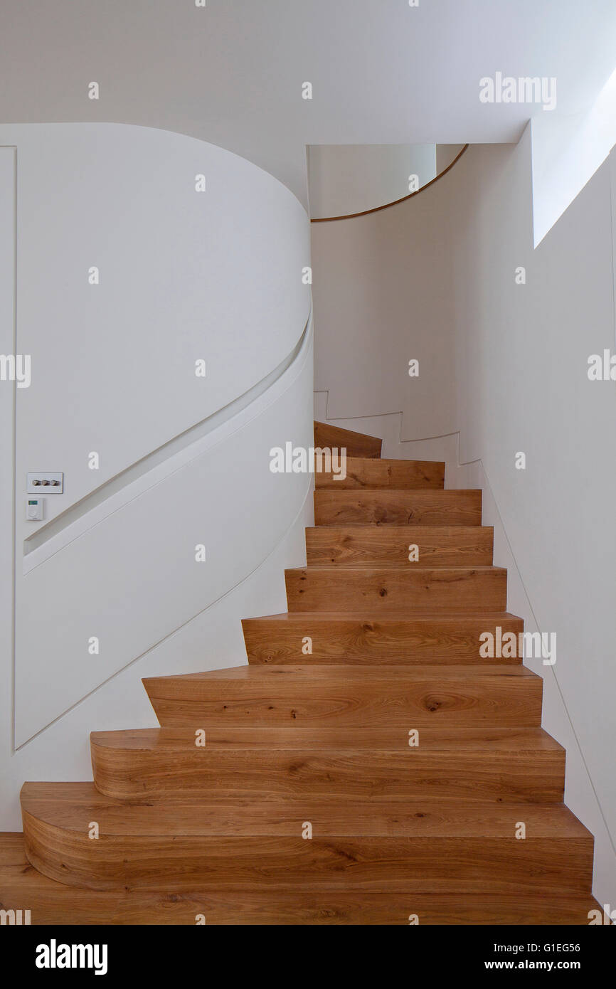 Modern Family home, Shepherds Bush, London. Spiral wood staircase and white walls. - Stock Image