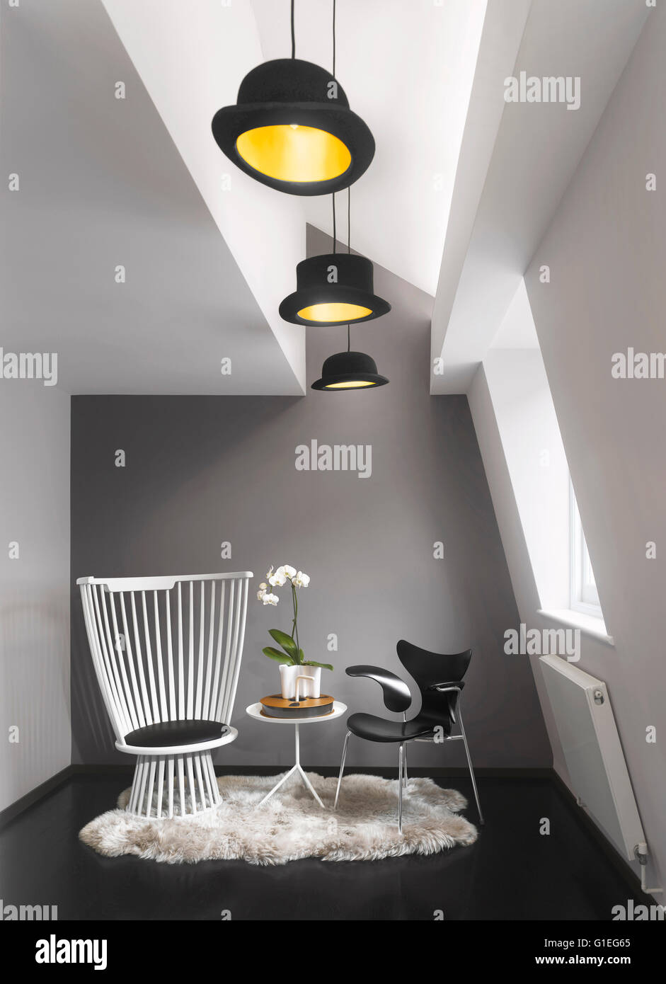 Dressing Room in attic space at front of house. Modern furniture in a monochrome space - Stock Image