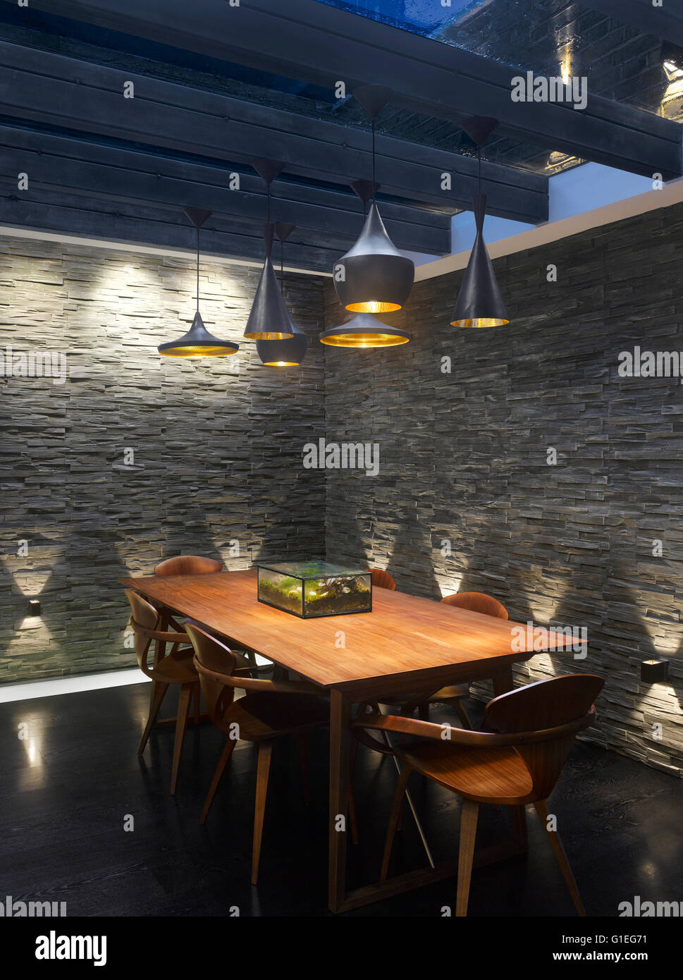 Dining Room. Modern dining table and decoration. - Stock Image