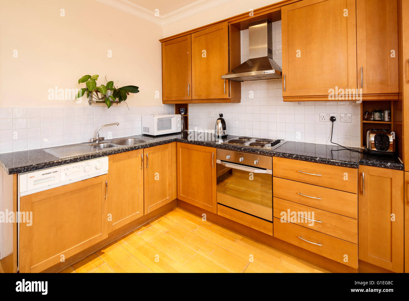 Belsize Lane, Hampstead. Kitchen with wood cabinets and floors. Stock Photo