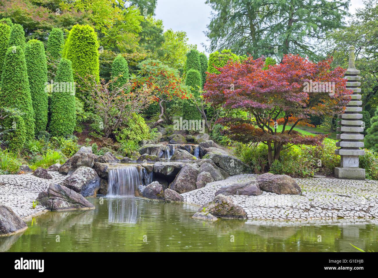 Cascade waterfall in Japanese garden in Bonn, Germany - Stock Image