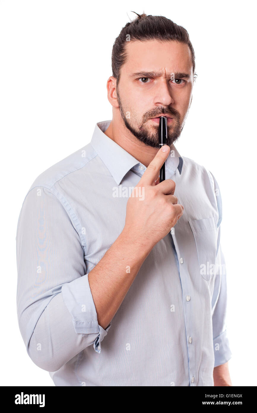 Young man thinking and angry - Stock Image