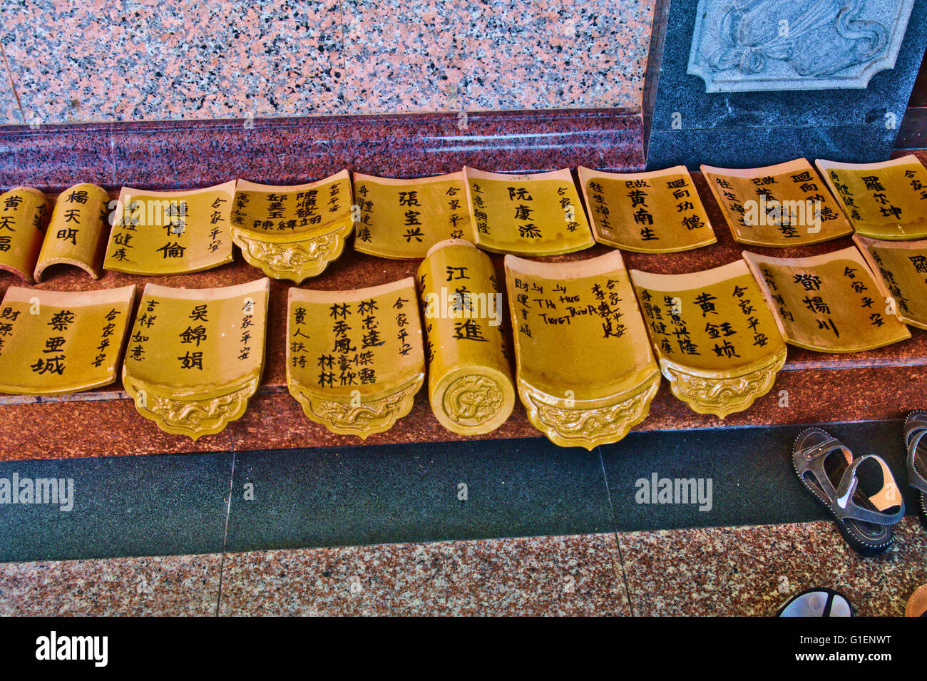 Buddhist artifacms on display during Chinese New Year celebrations at Kek Lok Si Temple in Penang, Malaysia on Friday - Stock Image