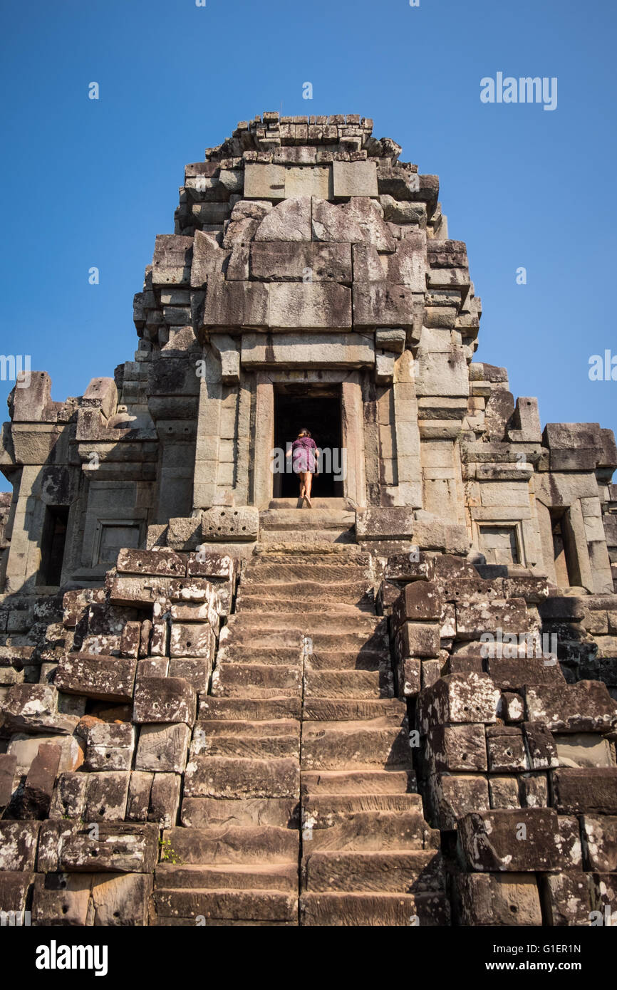 A tourist at Chau Say temple in the Siem Reap, Cambodia - Stock Image