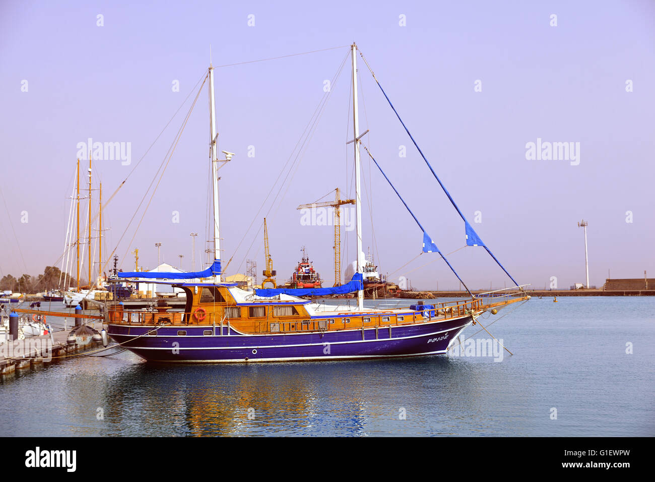 Wooden hull yacht moored in Burriana Harbour, Spain Stock Photo