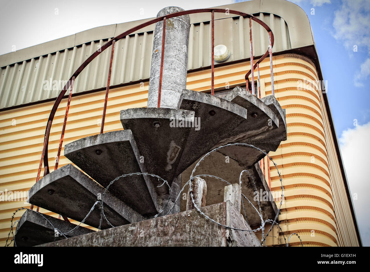 Spiral Staircases With Iron Railing Once Use As A Fire Escape On A Metal  Abadon Warehouse
