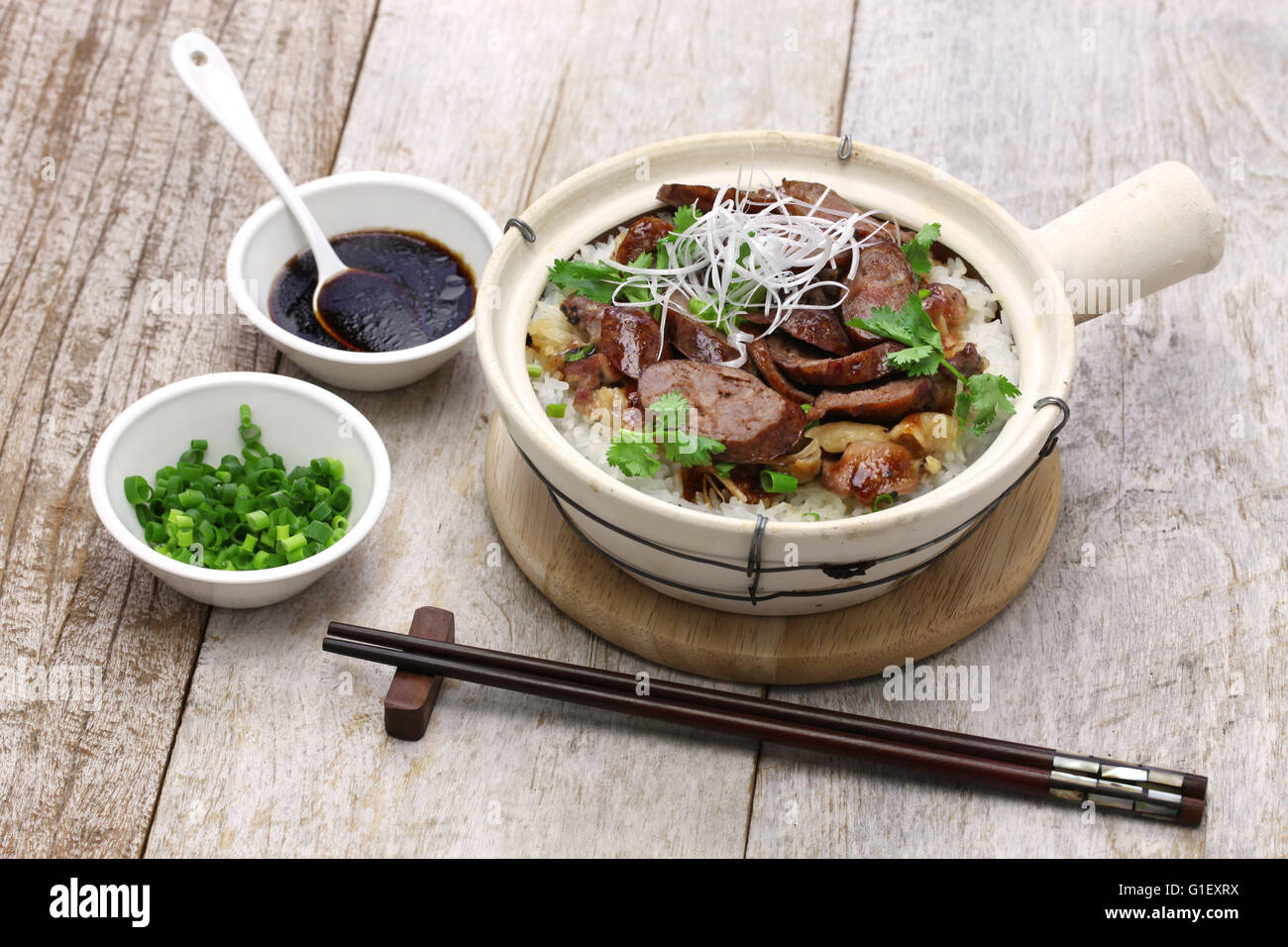 chinese sausage and chicken with rice in clay pot, cantonese food - Stock Image