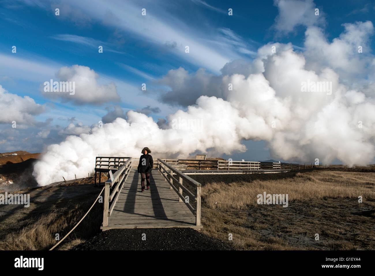 Tourist visiting Gunnuhver hot springs West Iceland - Stock Image