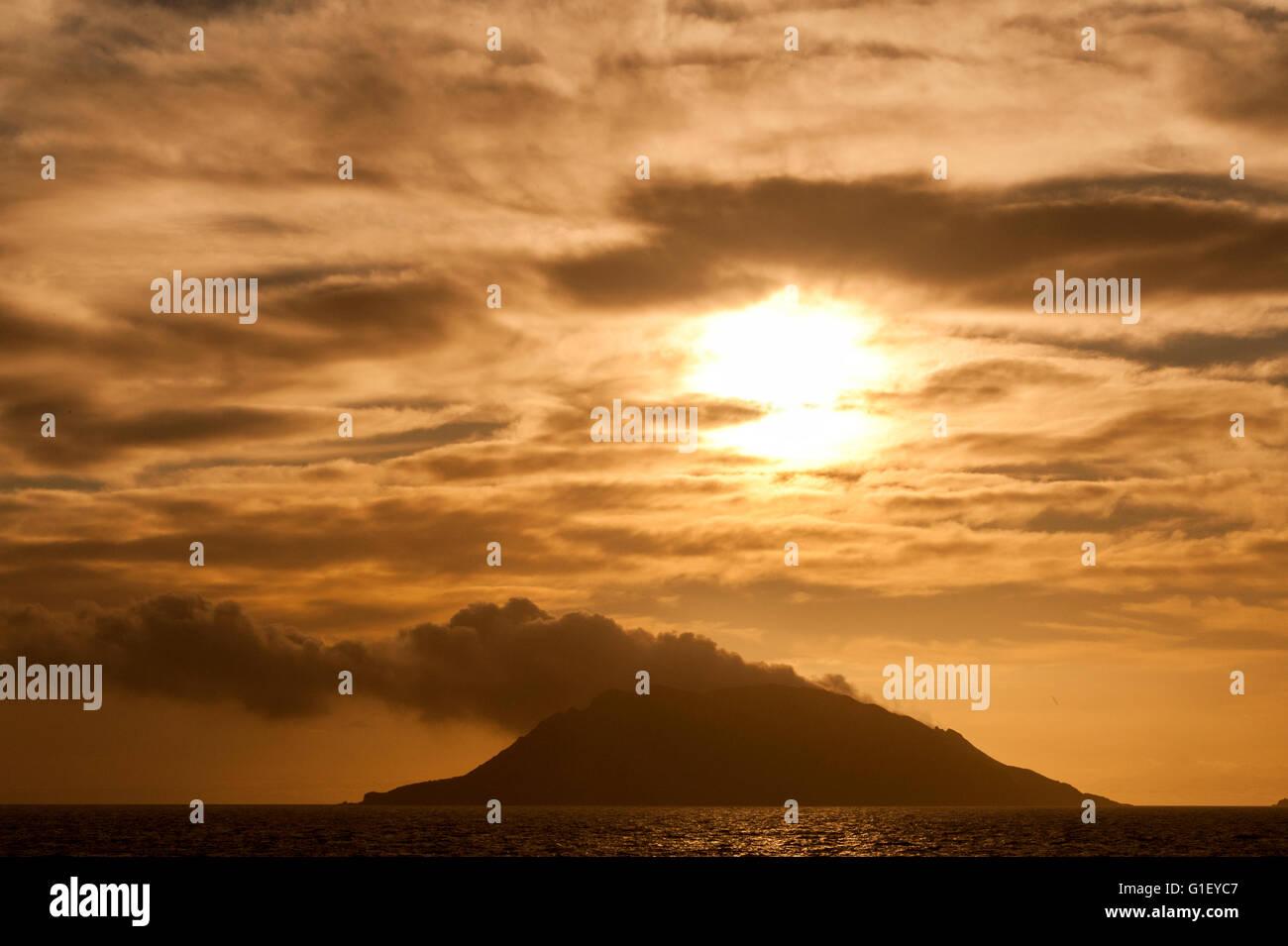 Sunrise over active volcano Whakaari White Island New Zealand - Stock Image