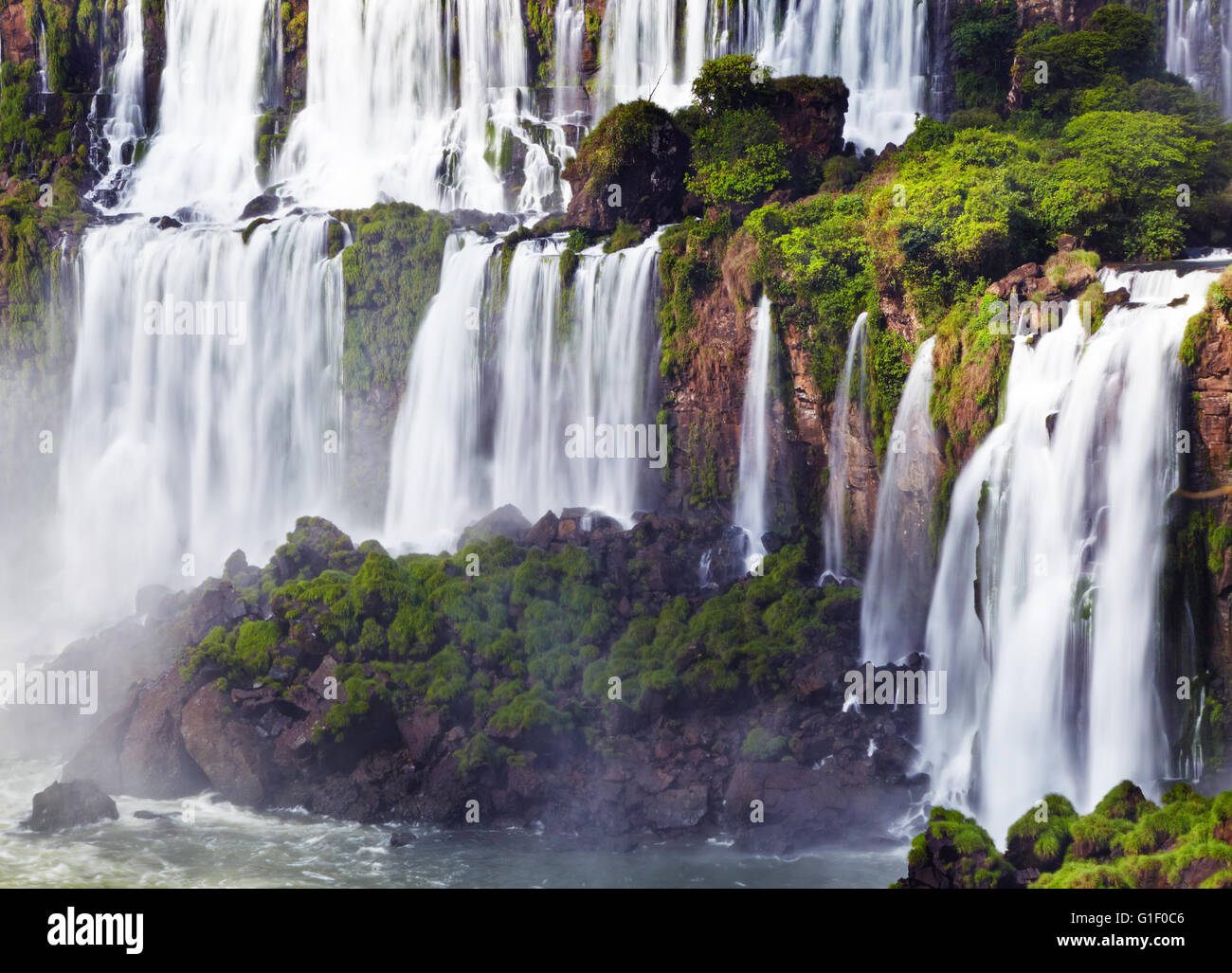 Iguasu Falls, the largest series of waterfalls of the world, located at the Brazilian and Argentinian border View - Stock Image