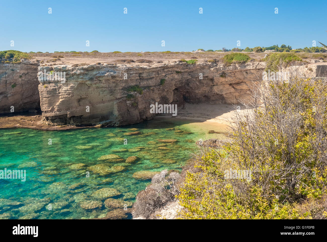 Rocky cliff and transparent sea in the natural reserve of Plemmirio, near Syracuse - Stock Image