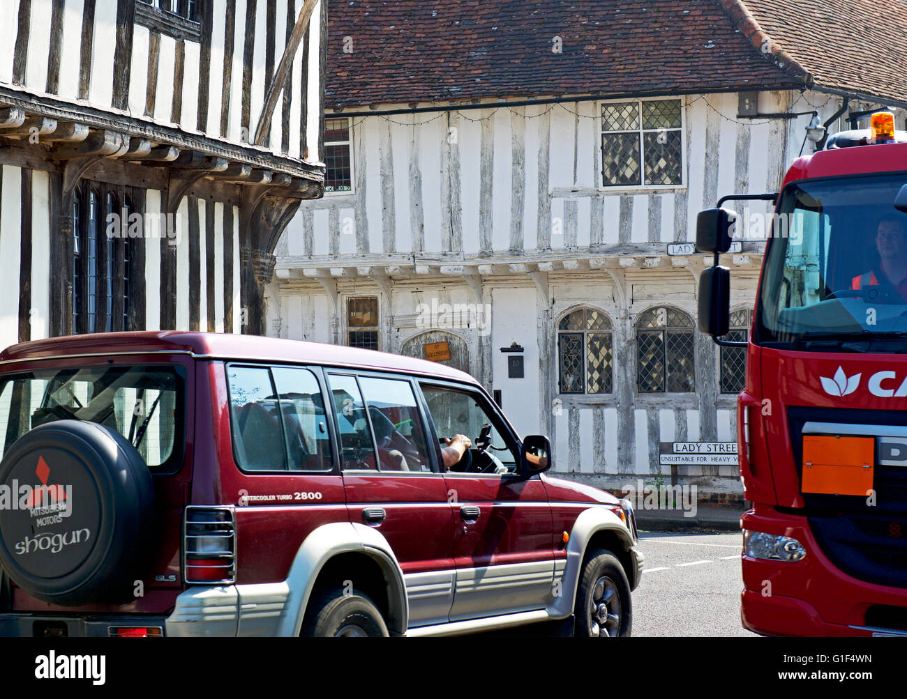Traffic in the medieval village of Lavenham, Suffolk, England UK - Stock Image