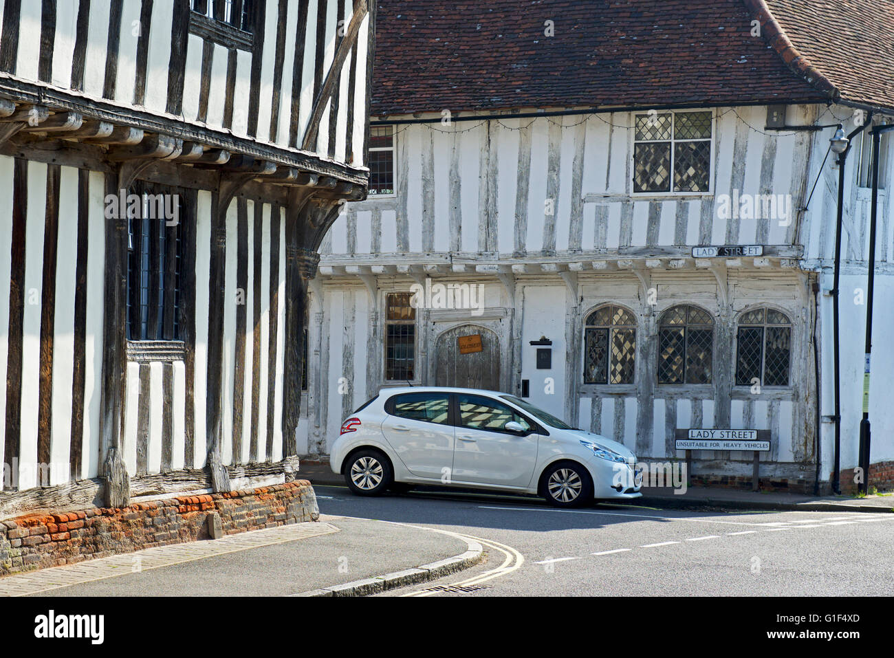 Car in the medieval village of Lavenham, Suffolk, England UK - Stock Image