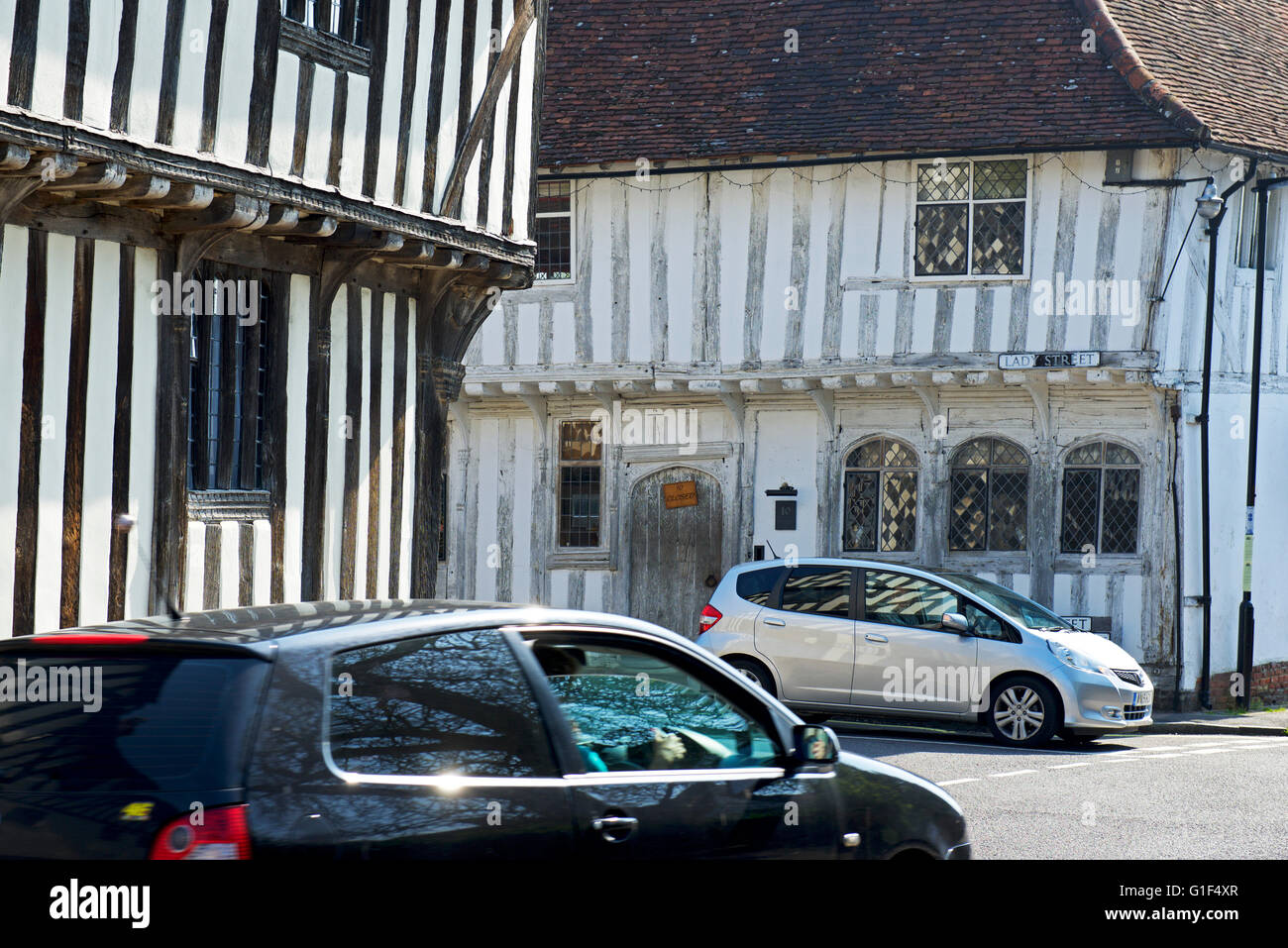 Cars in the medieval village of Lavenham, Suffolk, England UK - Stock Image