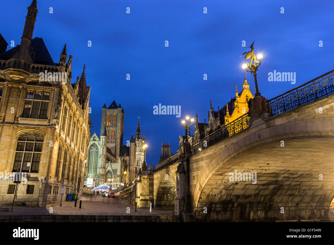 Historical centre of Ghent with old post office, Saint-Nicholas Church and Belfry during Christmas - Stock Image