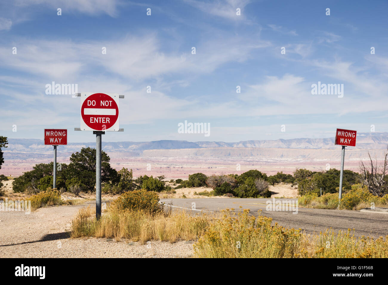 wrong way and do not enter signs along a road in the desert southwest - Stock Image