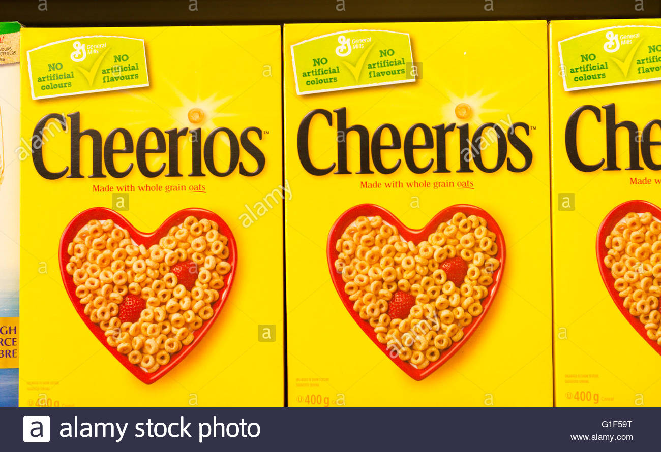 Cheerios is an American brand of breakfast cereals manufactured by General Mills, consisting of pulverized oats - Stock Image