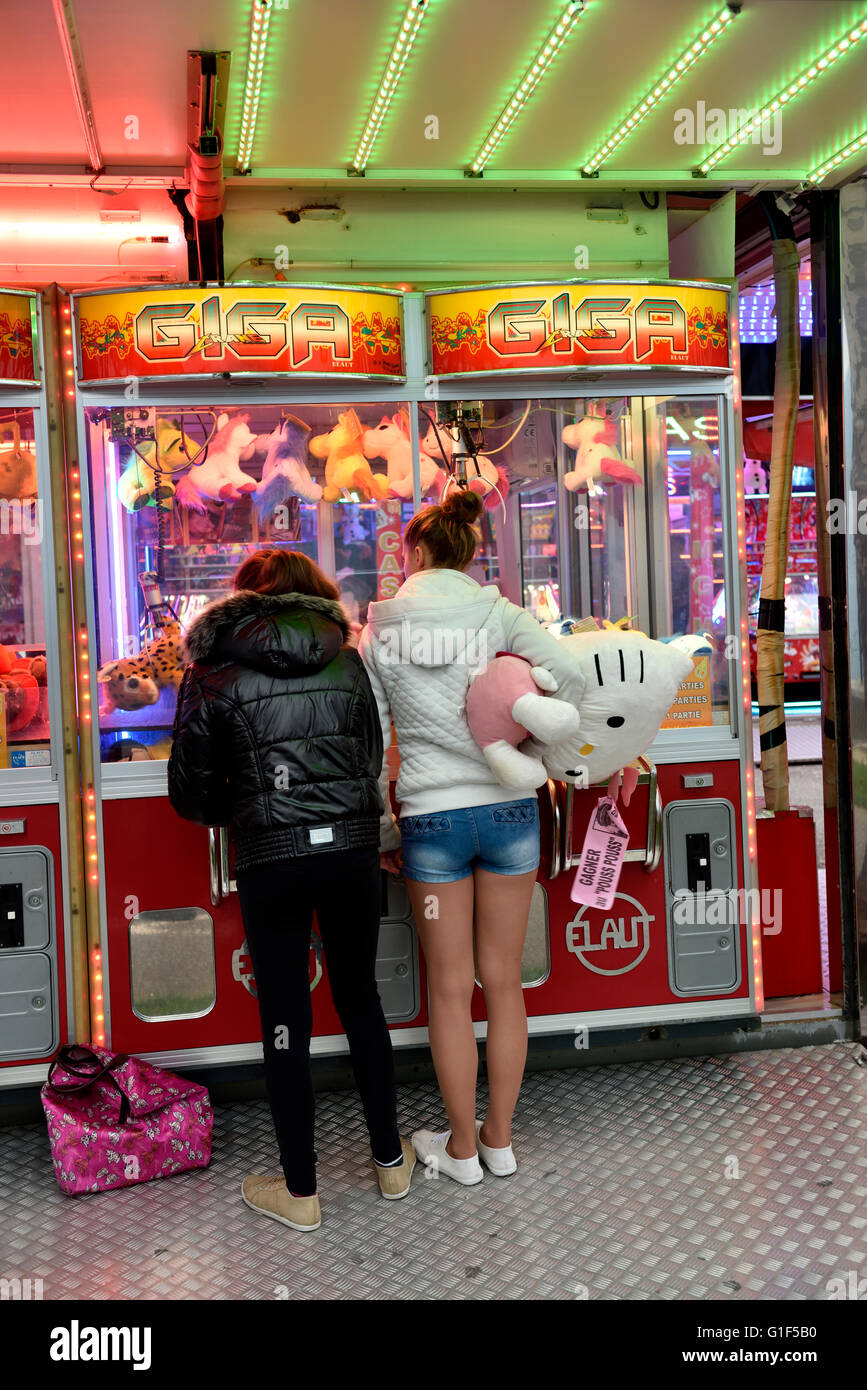 Travelling funfair grab machine in Aix-les-Bains southeast France - Stock Image