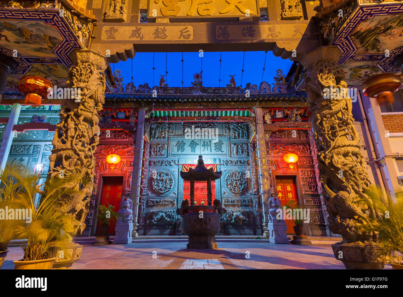 Dusk view of illuminated Hainan Temple, UNESCO Heritage Site, George Town, Penang, Malaysia Stock Photo