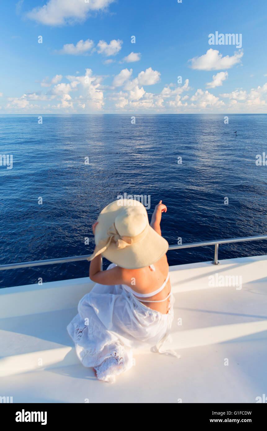 Woman dolphin watching on boat, South Male Atoll, Kaafu Atoll, Maldives (MR) - Stock Image