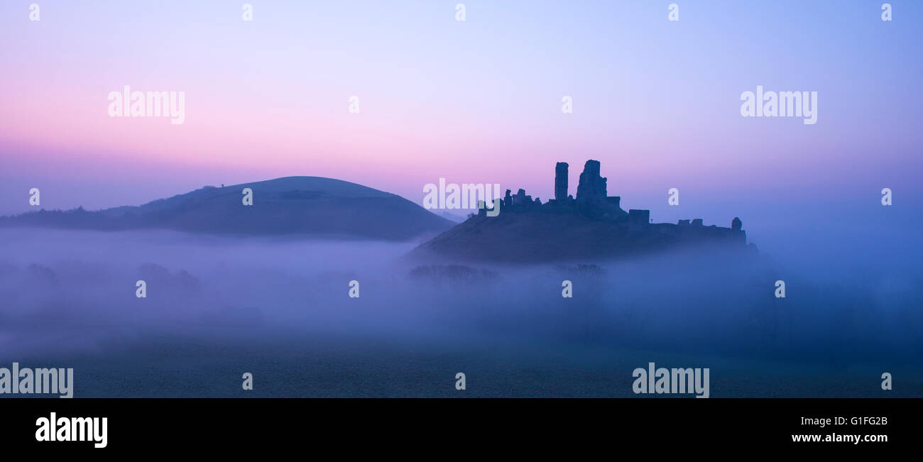 A misty morning at Corfe Castle in Dorset. - Stock Image