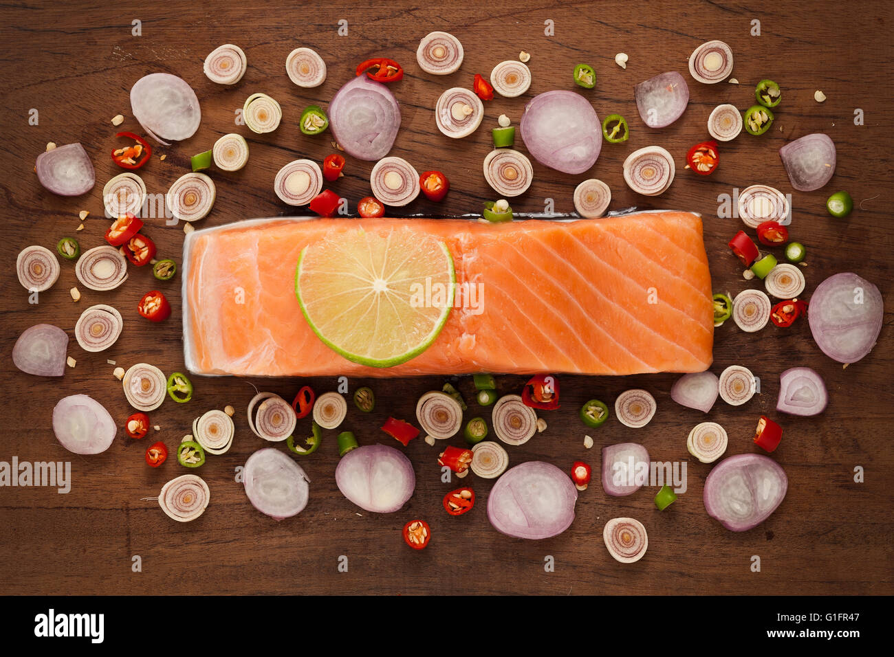 salmon steak spicy food salad ingredient rustic still life lemon lemongrass onion shallot paprika chilli Stock Photo