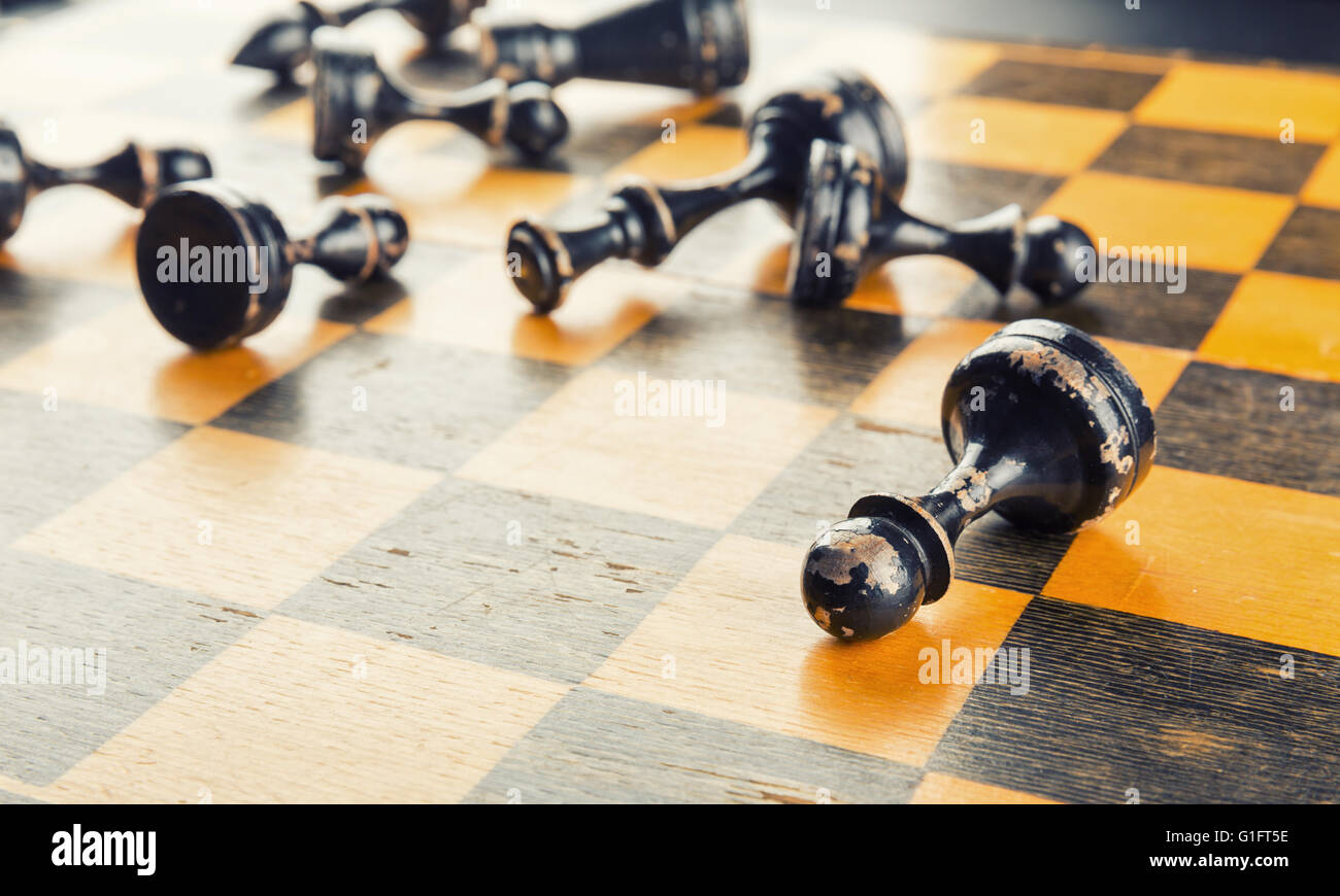Chess figures defeated - Stock Image
