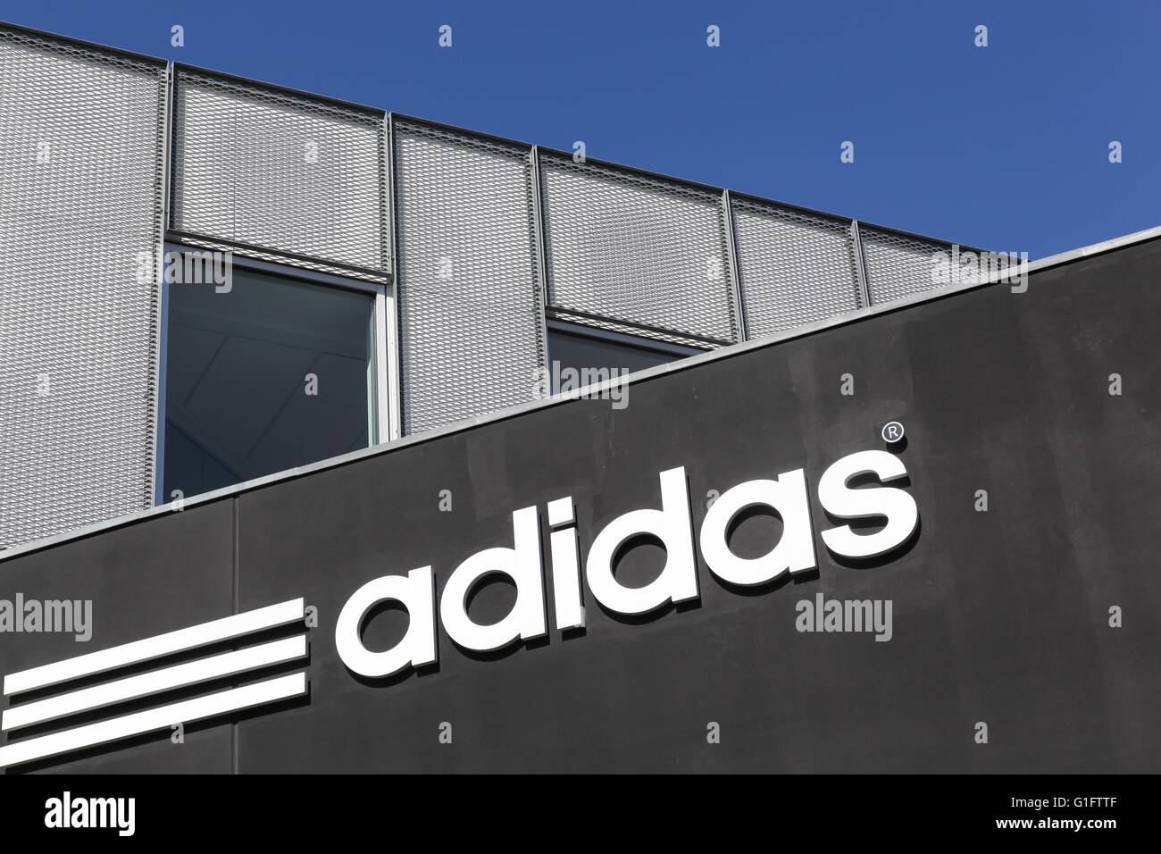 Adidas logo on a wall - Stock Image