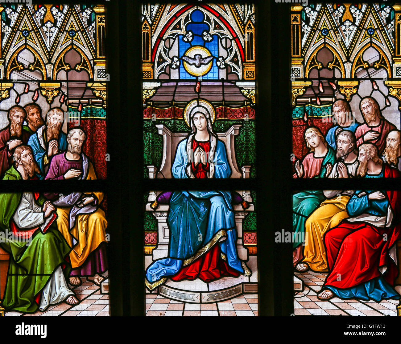 Stained Glass in the Basilica of Vysehrad in Prague, Czech Republic, depicting the Descent of the Holy Spirit at - Stock Image