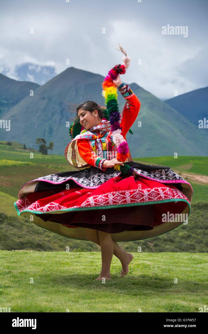 Quechua woman dancing in performance at El Parador de Moray, Sacred Valley, Peru. - Stock Image