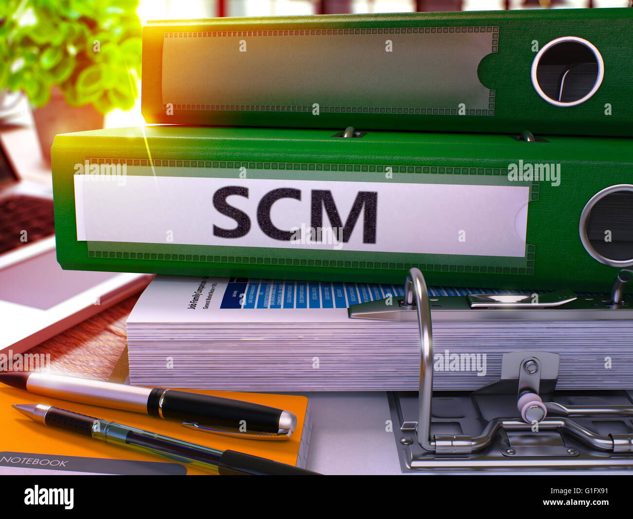 Green Office Folder with Inscription SCM. Stock Photo