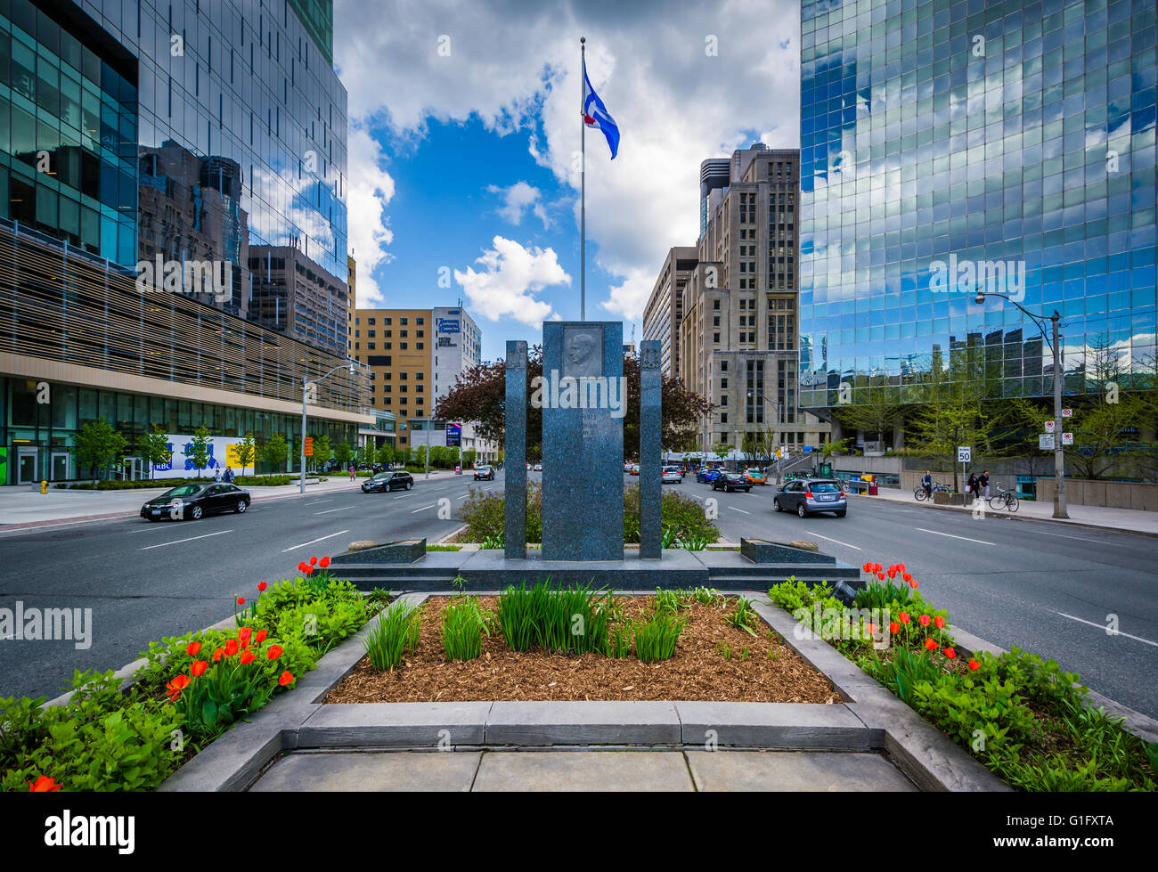 Gardens and memorial in the median of University Avenue, and modern buildings in the Discovery District, of Toronto, - Stock Image
