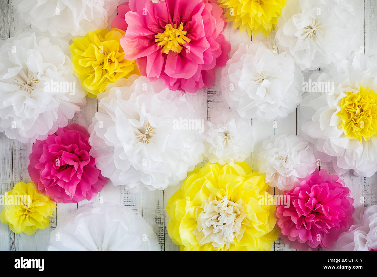 Paper handmade flowers isolated on white wood background beautiful paper handmade flowers isolated on white wood background beautiful floral background of white pink and yellow colors mightylinksfo