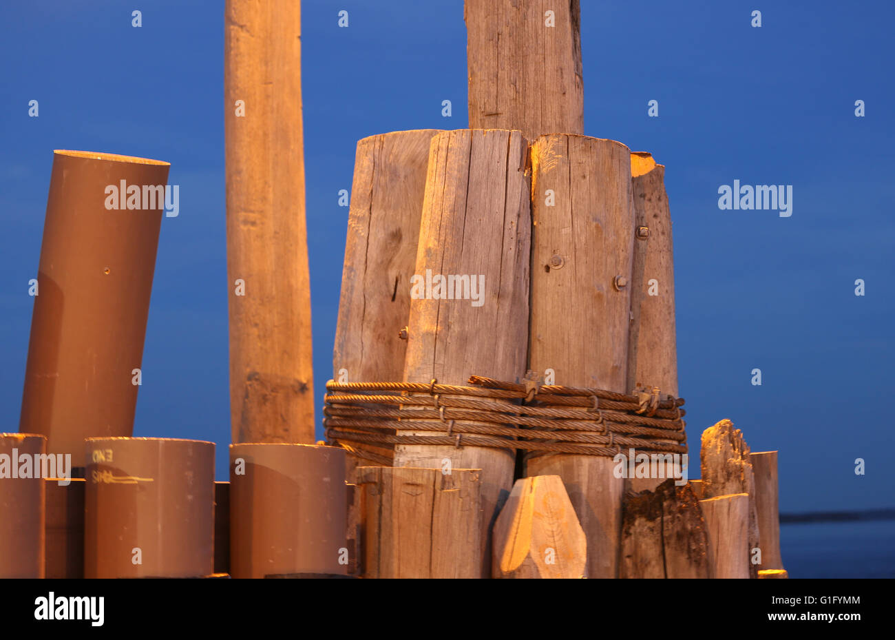 wood and synthetic pilings at a ferry landing - Stock Image