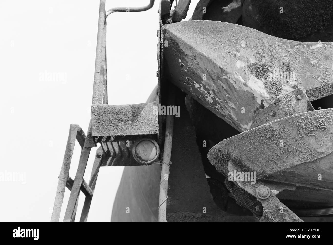 black and white detail of a concrete mixer truck parts - Stock Image