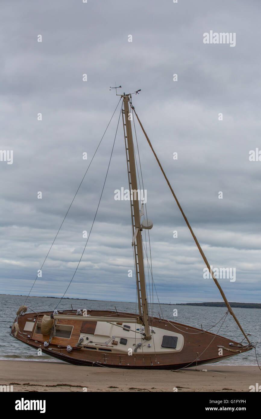 beached sailboat at Haven's Beach, Sag Harbor, NY - Stock Image