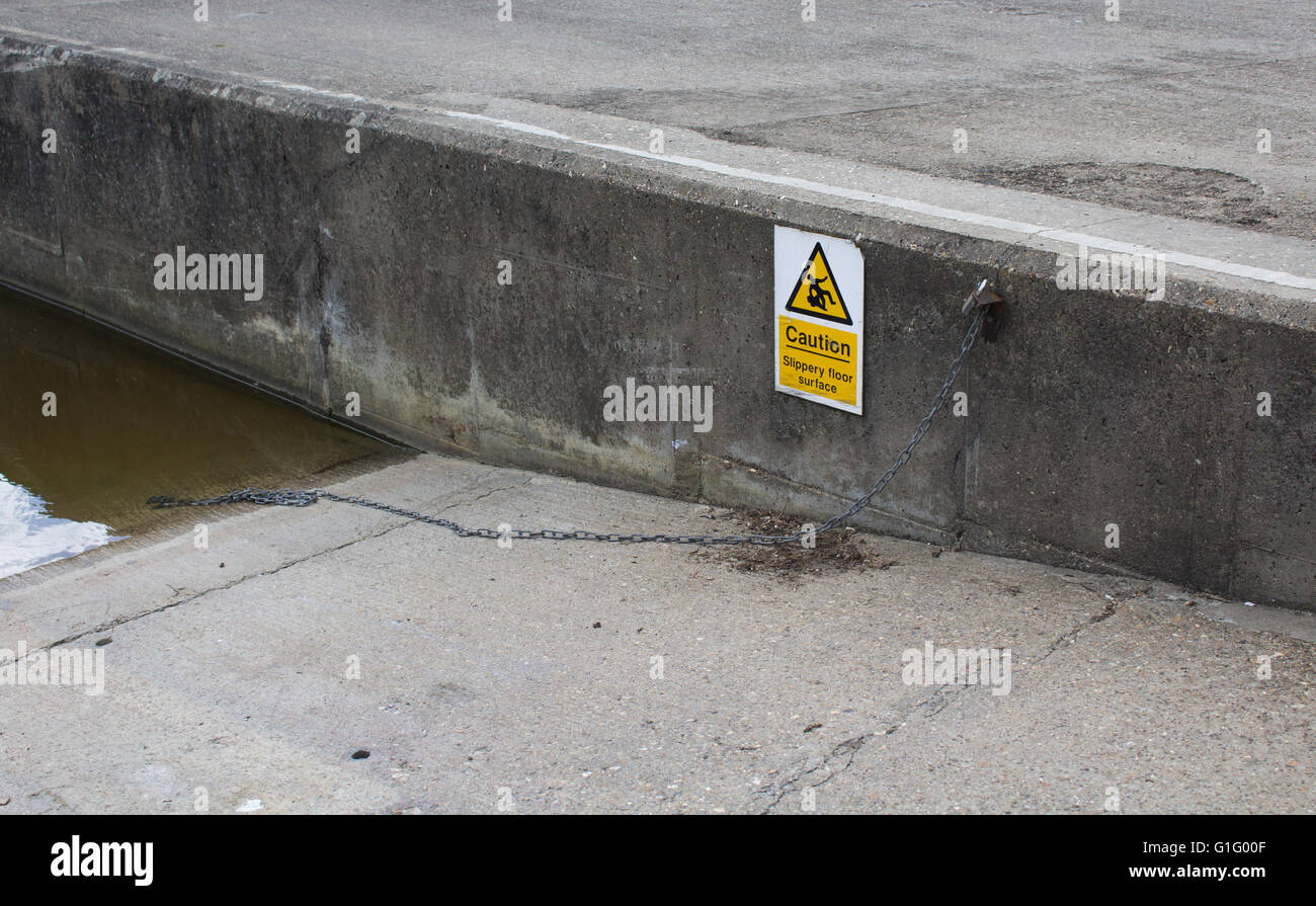 Slippery Floor Surface Sign on Boat Launch at boatyard in Wallingford, Oxfordshire, UK - Stock Image