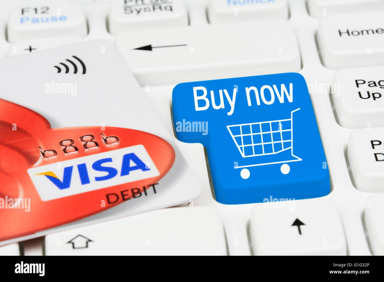 Shopping online. Online shopping button on a computer keyboard.with Visa debit card. - Stock Image