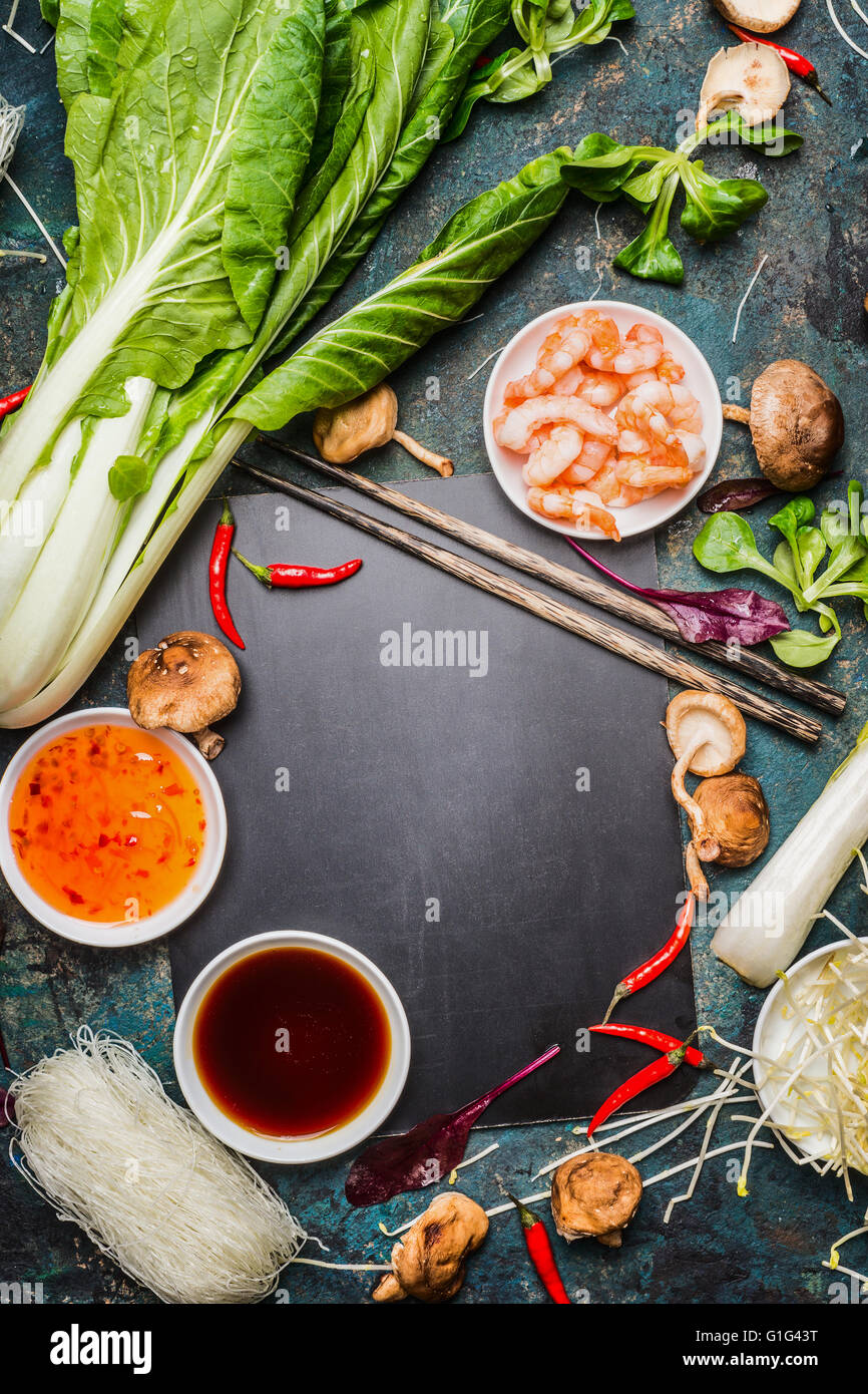 Asian food background with cooking ingredients chopsticks and stock asian food background with cooking ingredients chopsticks and sauces frame forumfinder Images