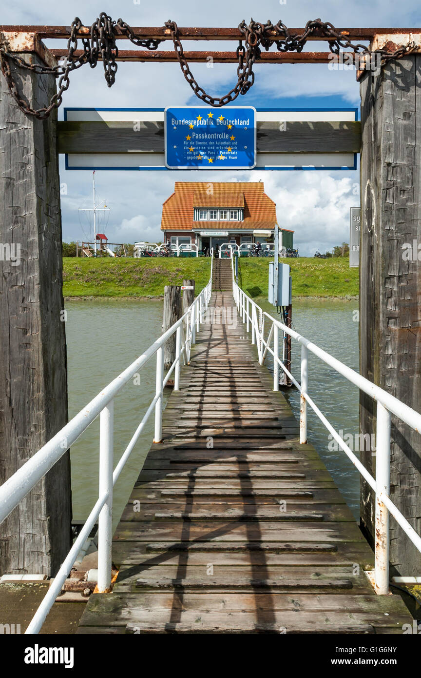 Passport control sign on jetty in harbour of East-Frisian island Langeoog, Lower Saxony, Germany Stock Photo