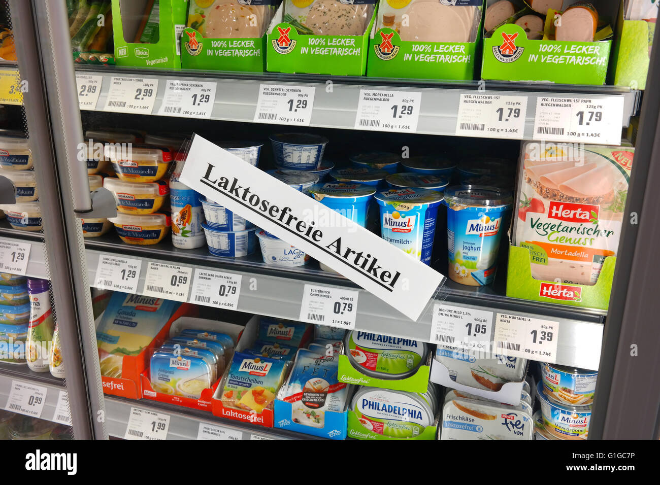 Label in German for Lactose free refrigerated fresh products in a supermarket. Stock Photo