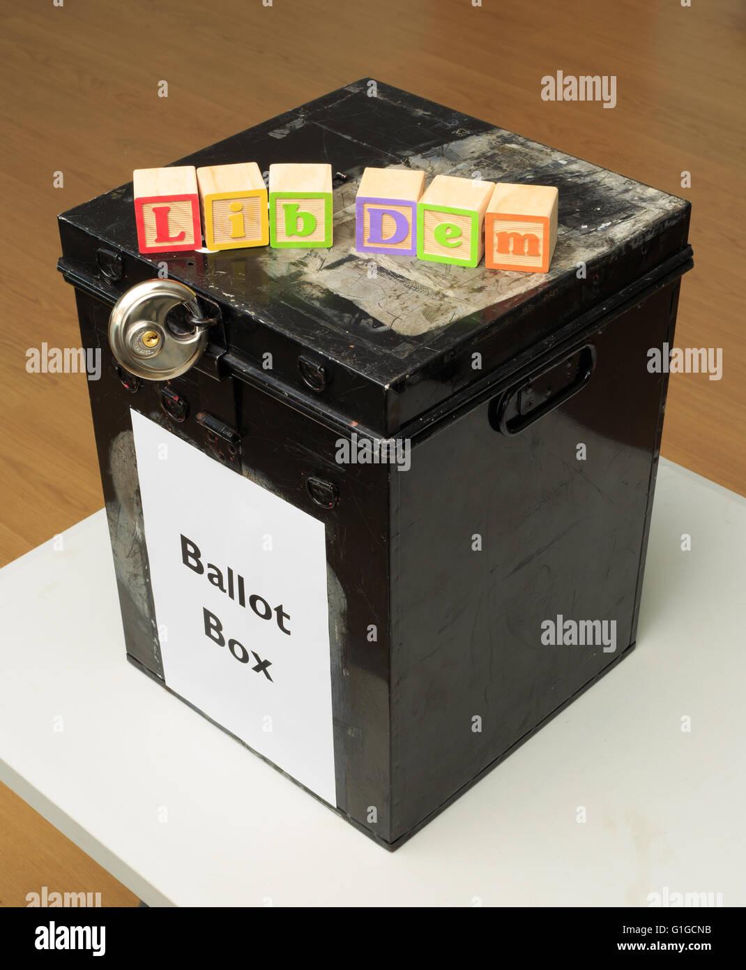 UK ballot box and childs' ABC blocks stating 'Lib Dem' in reference to British politics. - Stock Image