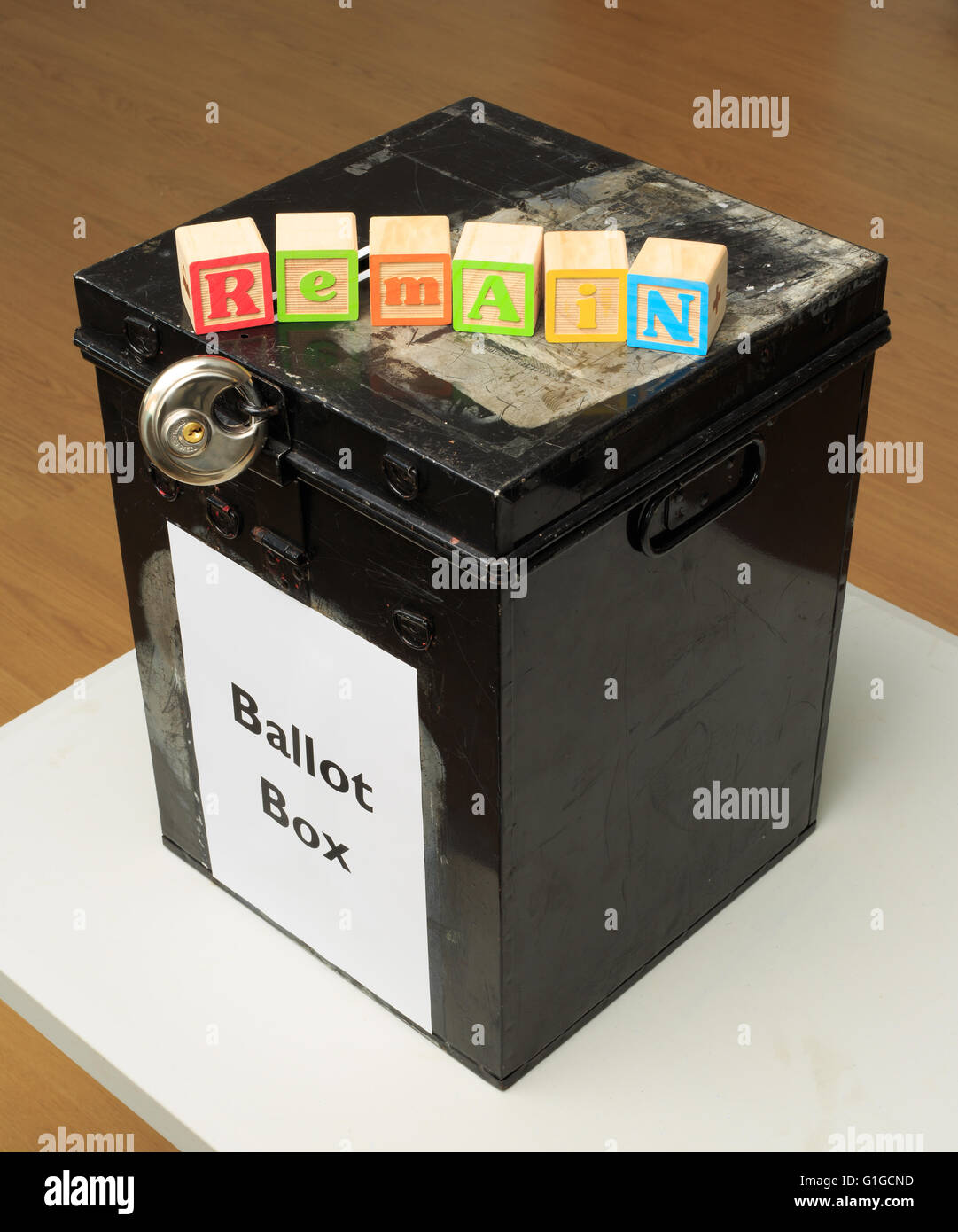UK ballot box and childs' ABC blocks stating 'Remain' in reference to the referendum on EU membership - Stock Image