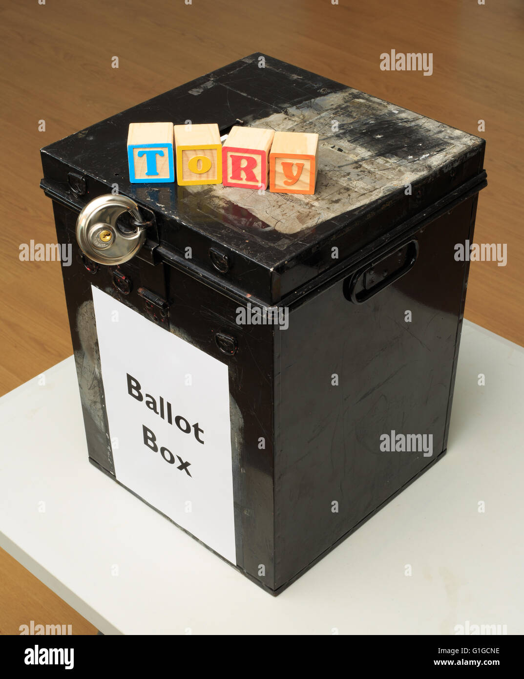 UK ballot box and childs' ABC blocks stating 'Tory' in reference to British politics. - Stock Image