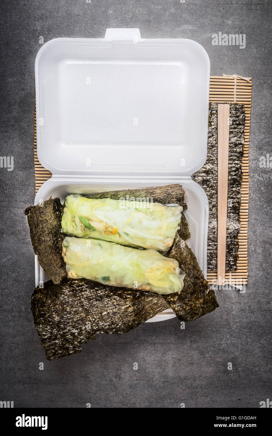Rice paper paper rolls  in white transport box , top view. Fresh asian Summer Rolls. - Stock Image