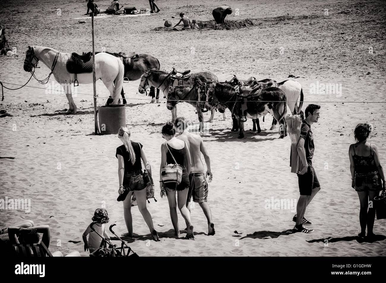 Holiday makers both adult and children playing on the beech at Barry Island South Wales UK during the summer of Stock Photo