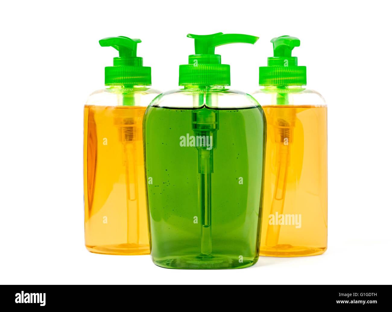 Three liquid soap dispenser plastic bottles isolated on white - Stock Image