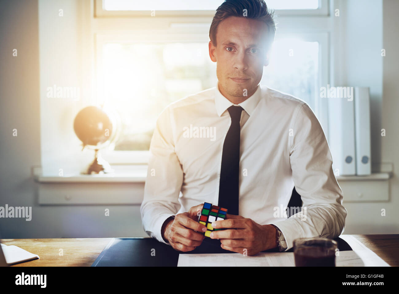 Successful business man solving problems at his desk, consultant and success concept - Stock Image